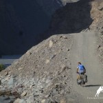 Cyclist in Bartang valley, Pamir highway,Tajikistan