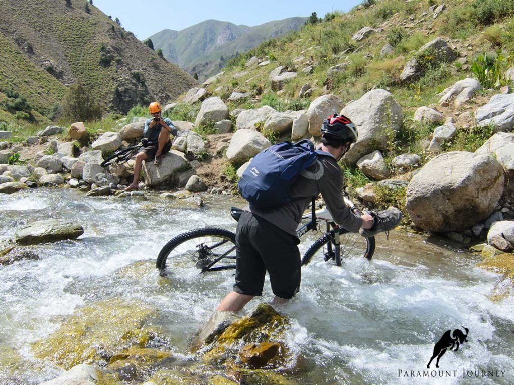 mountain bike crossing river